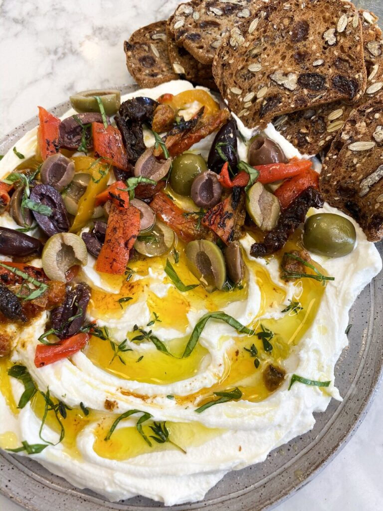 Goat-Cheese-spread-with-sun-dried-tomatoes,-olives-and-roasted-red-peppers