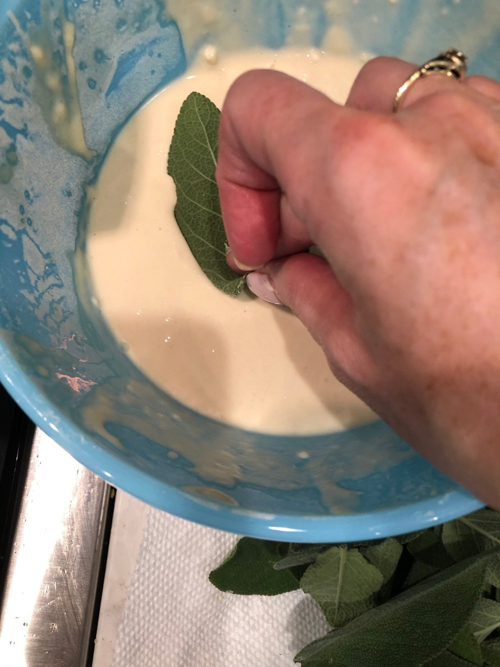 Be sure to coat both sides of the leaf with the batter.