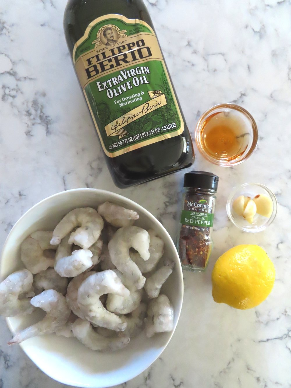 Ingredients - Olive oil, sherry, lemon, garlic, crushed red pepper and shrimp. Typically I would use fresh shrimp but I had these in the freezer and thought I would use them up.