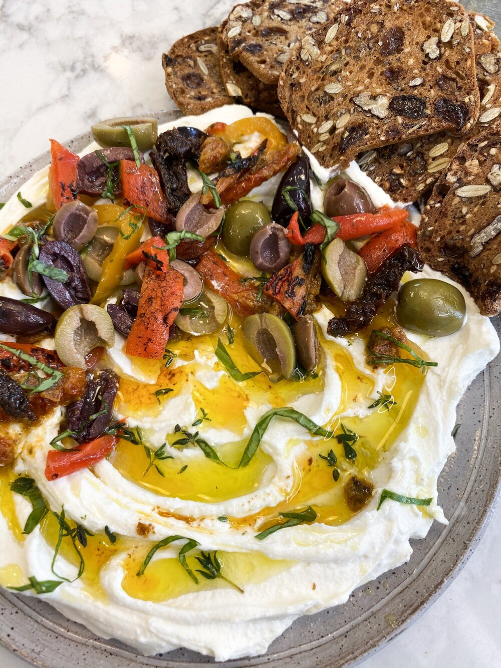 Goat Cheese spread with sun-dried tomatoes, olives and roasted red peppers