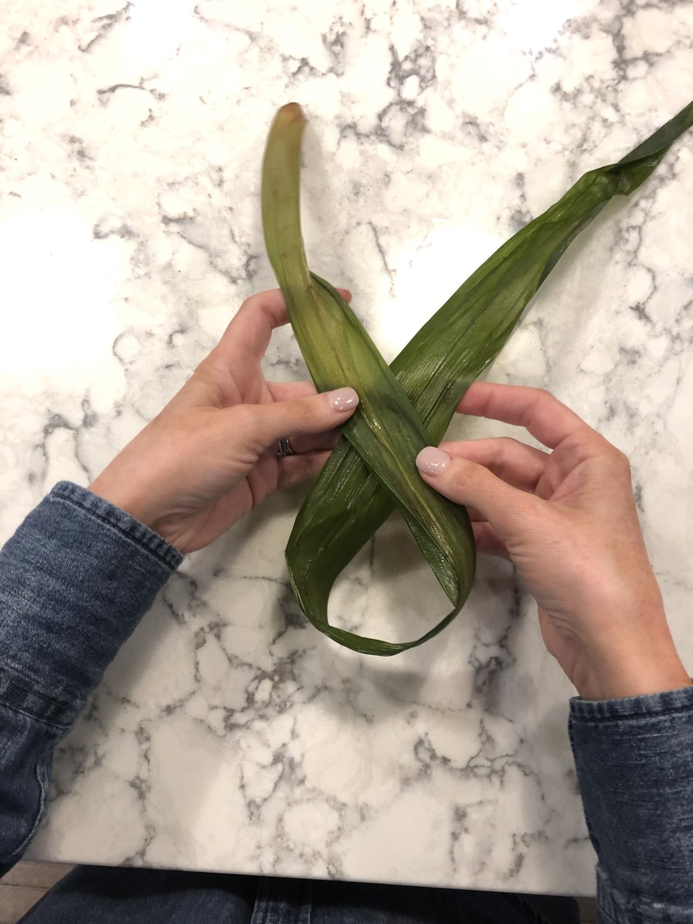 step 2 - take the RIGHT side and place over, or on top of, the left side. it should look like an upside down ribbon.