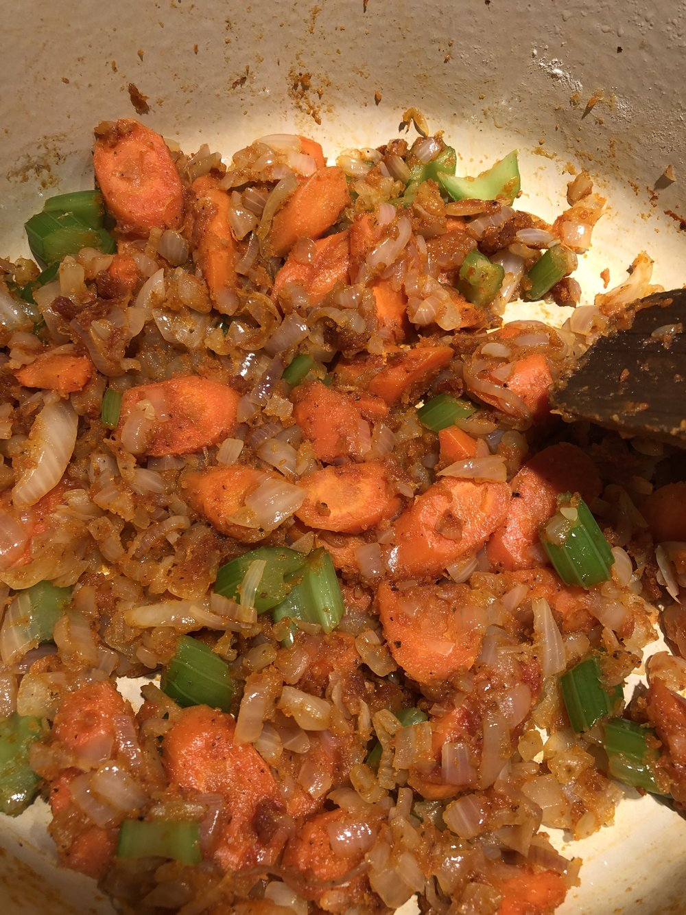 Cook onions, shallot, carrots and celery with tomato paste
