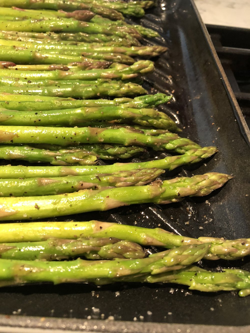 ASparagus cooks up quick on a grill pan. I toss it in olive oil, salt and pepper and finish with a little lemon.