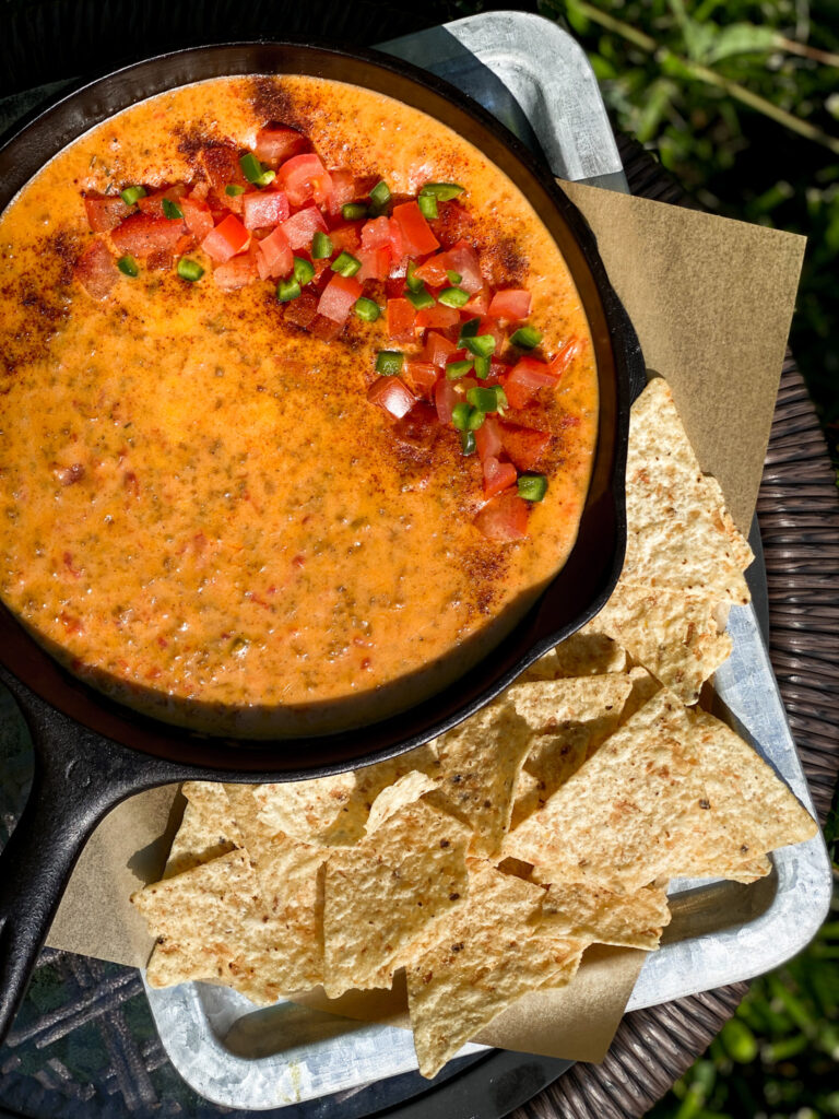CHORIZO QUESO DIP with tomatoes and jalapenos