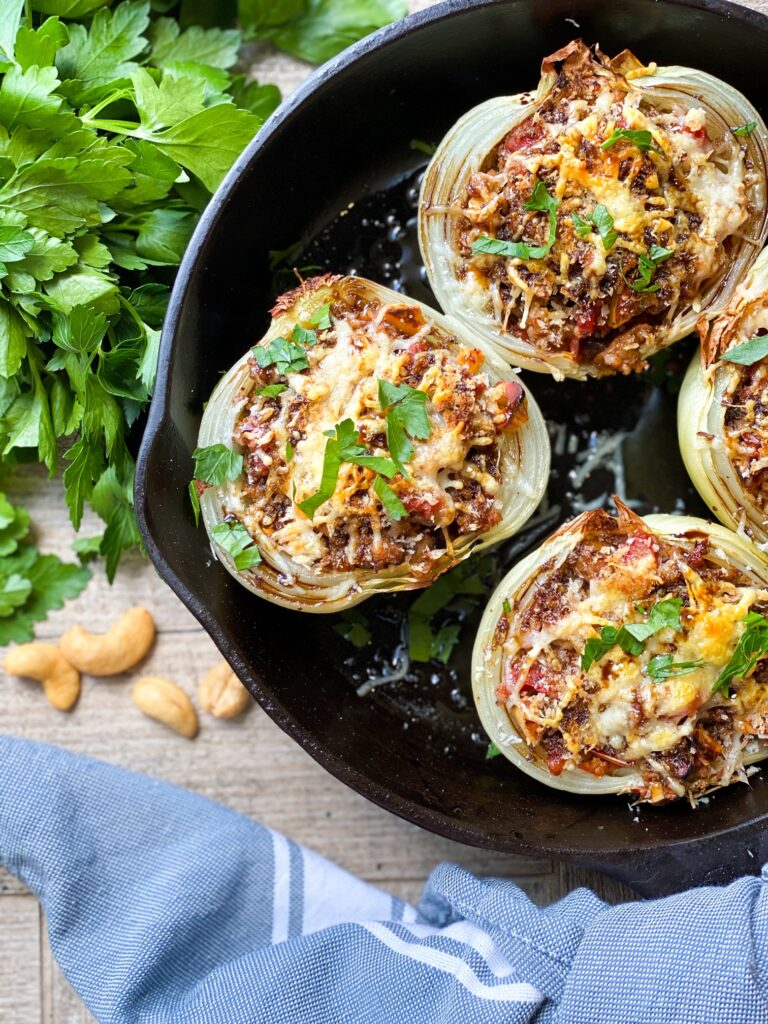 SAUSAGE STUFFED ONIONS in a cast iron skillet