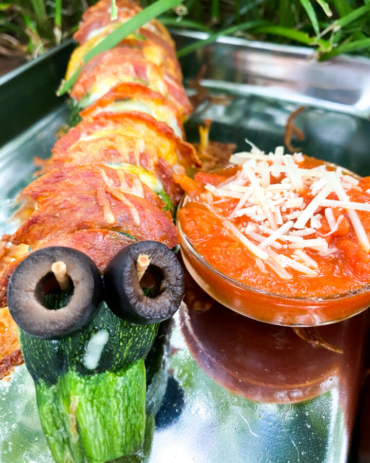 Zucchini stuffed with pepperoni and cheese made to look like a Caterpillar