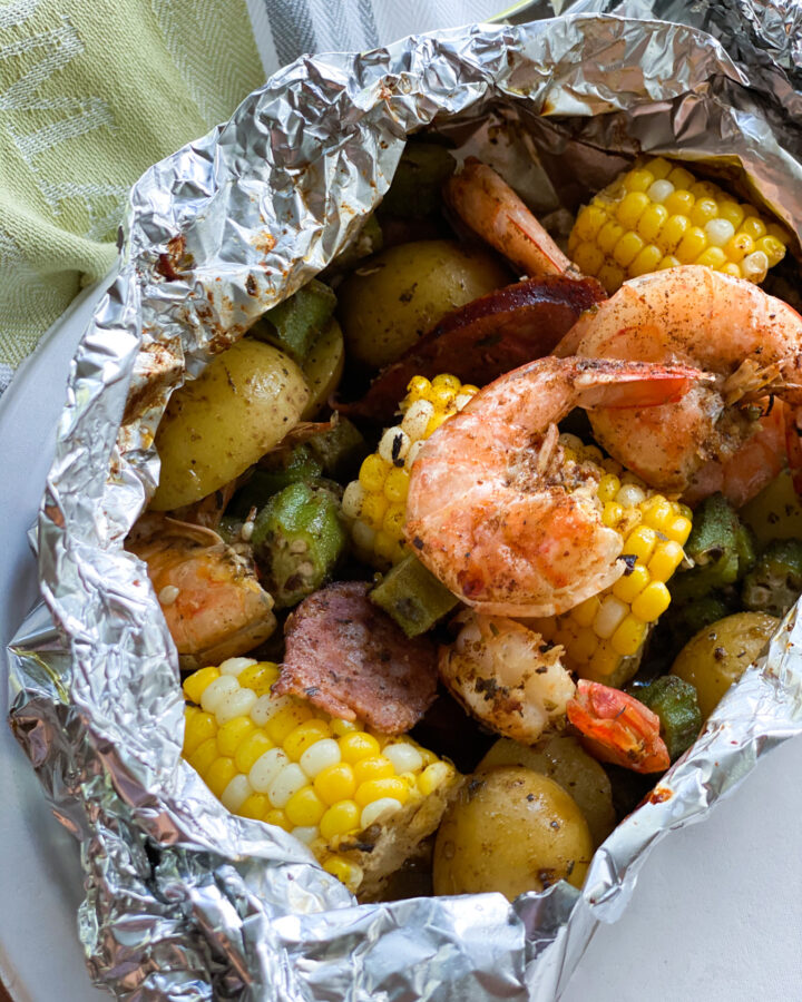 Shrimp, corn on the cob, potatoes and andouille sausage in a foil packet