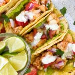 SHRIMP STREET TACOS in a corn tortilla with a side of lime